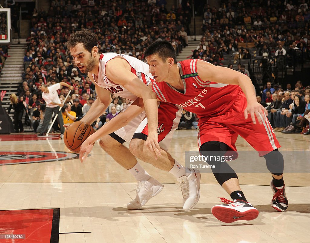 Jose Calderon #8 of the Toronto Raptors drives against Jeremy Lin #7 of the Houston Rockets during the game between the Toronto Raptors and the Houston Rockets December 16, 2012 at the Air Canada Centre in Toronto, Ontario, Canada.