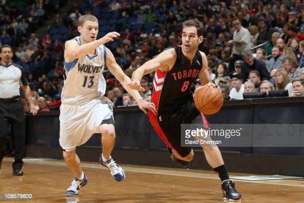 Jose Calderon of the Toronto Raptors drives against Luke Ridnour of the Minnesota Timberwolves on January 29 2011 at Target Center in Minneapolis...