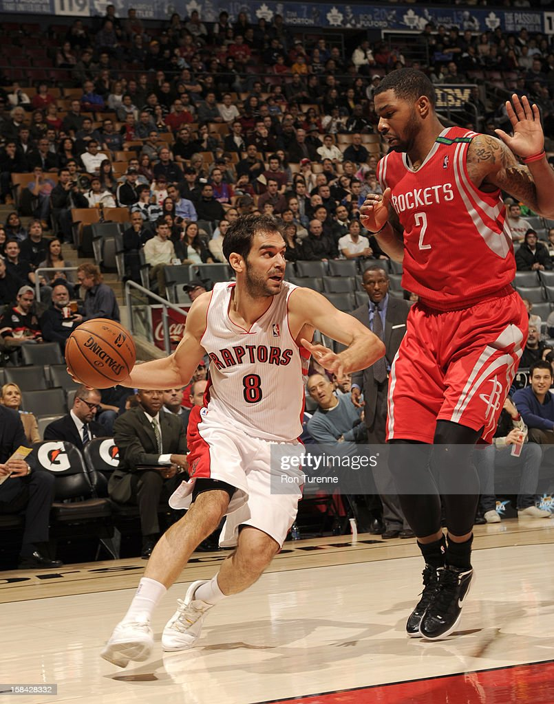 Jose Calderon #8 of the Toronto Raptors drives against Marcus Morris #2 of the Houston Rockets during the game between the Toronto Raptors and the Houston Rockets December 16, 2012 at the Air Canada Centre in Toronto, Ontario, Canada.