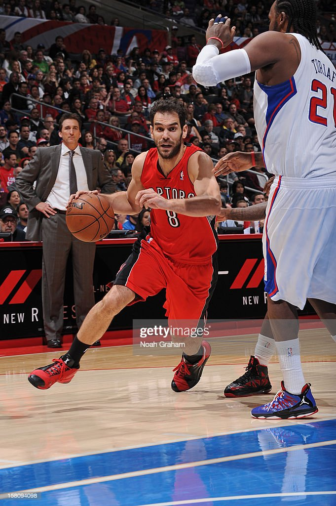 Jose Calderon #8 of the Toronto Raptors drives to the basket against <a gi-track='captionPersonalityLinkClicked' href=/galleries/search?phrase=Ronny+Turiaf&family=editorial&specificpeople=224998 ng-click='$event.stopPropagation()'>Ronny Turiaf</a> #21 of the Los Angeles Clippers on December 9, 2012 at the Staples Center in Los Angeles, California.