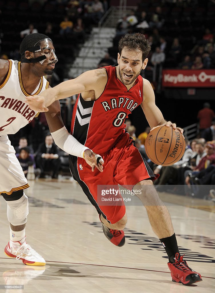 Jose Calderon #8 of the Toronto Raptors drives to the basket against Kyrie Irving #2 of the Cleveland Cavaliers at The Quicken Loans Arena on December 18, 2012 in Cleveland, Ohio.