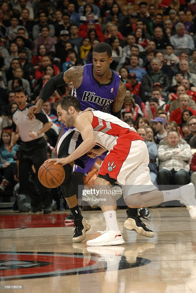 Jose Calderon #8 of the Toronto Raptors drives to the basket against Thomas Robinson #0 of the Sacramento Kings on January 4, 2013 at the Air Canada Centre in Toronto, Ontario, Canada.