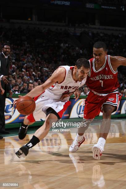 Jose Calderon of the Toronto Raptors drives to the basket against Ramon Sessions of the Milwaukee Bucks on November 1 2008 at the Bradley Center in...