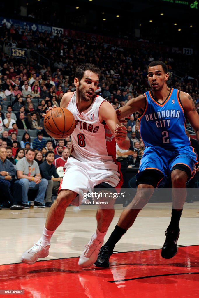 Jose Calderon #8 of the Toronto Raptors drives to the basket against the Oklahoma City Thunder on January 6, 2013 at the Air Canada Centre in Toronto, Ontario, Canada.