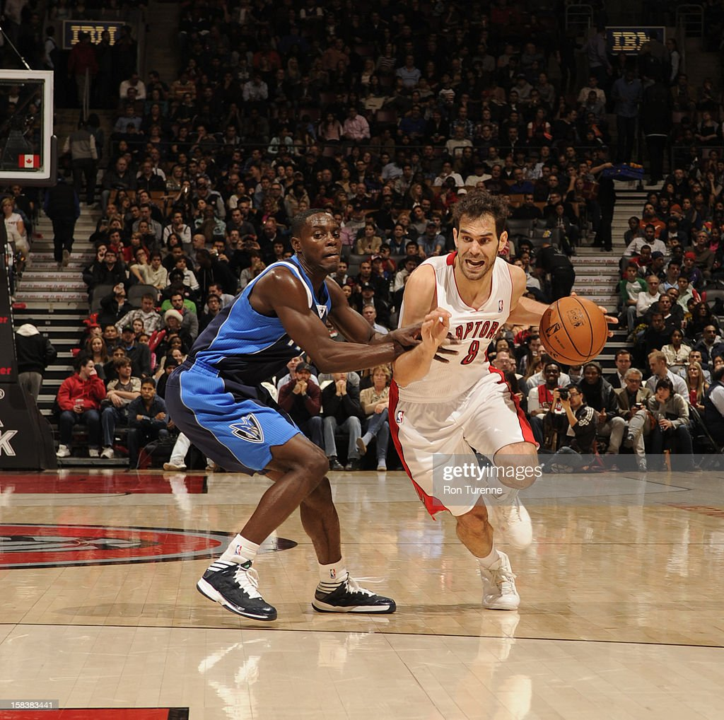 Jose Calderon #8 of the Toronto Raptors drives to the basket around <a gi-track='captionPersonalityLinkClicked' href=/galleries/search?phrase=Darren+Collison&family=editorial&specificpeople=699031 ng-click='$event.stopPropagation()'>Darren Collison</a> #4 of the Dallas Mavericks on December 14, 2012 at the Air Canada Centre in Toronto, Ontario, Canada.