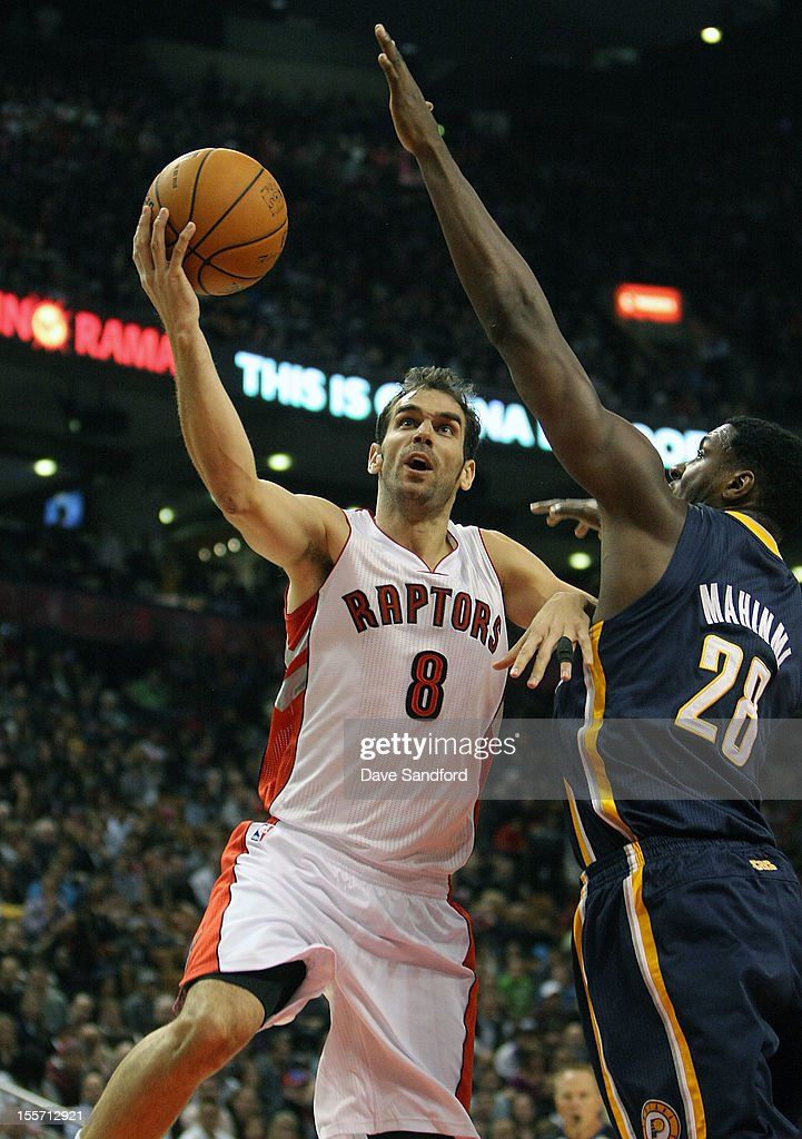 Jose Calderon #8 of the Toronto Raptors drives to the basket as Ian Mahinmi #28 of the Indiana Pacers defends on October 31, 2012 at the Air Canada Centre in Toronto, Canada.