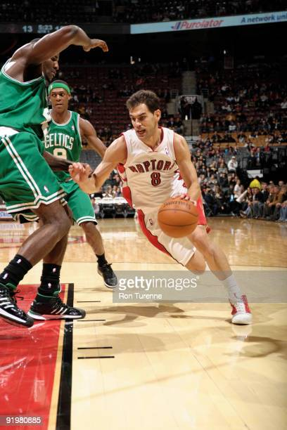 Jose Calderon of the Toronto Raptors drives to the net and gets around Kendrick Perkins of the Boston Celtics during a game on October 18 2009 at the...