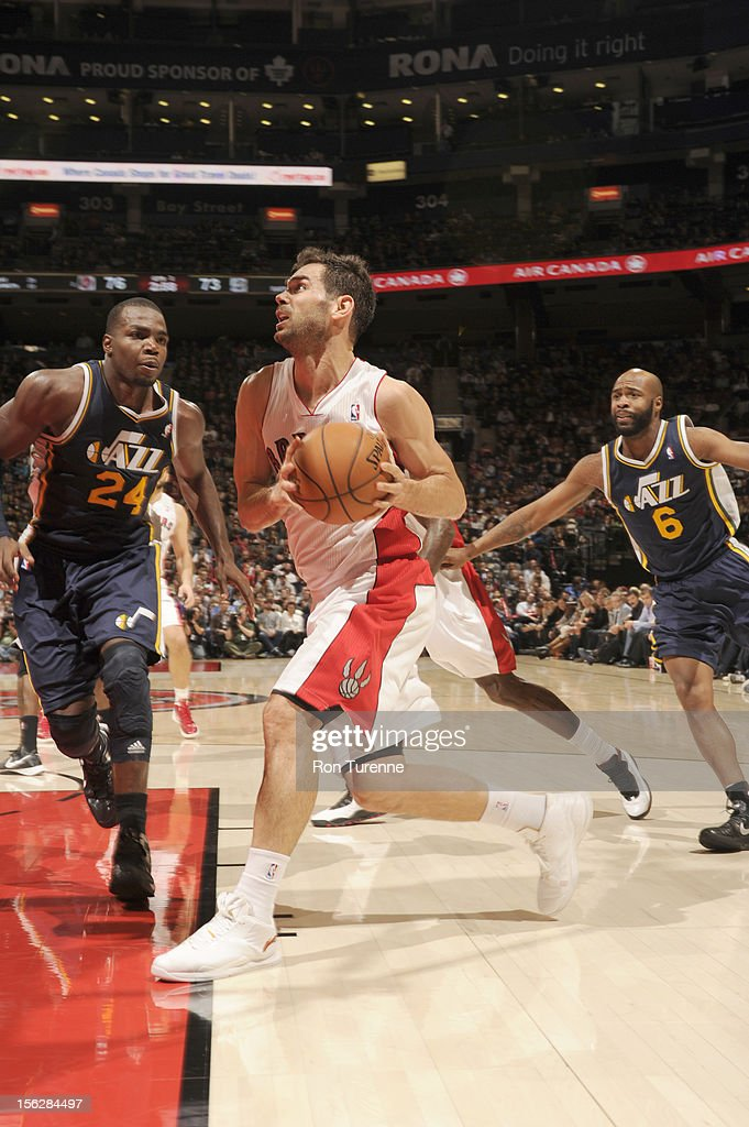 Jose Calderon #8 of the Toronto Raptors drives under pressure during the game between the Toronto Raptors and the Utah Jazz on November 12, 2012 at the Air Canada Centre in Toronto, Ontario, Canada.