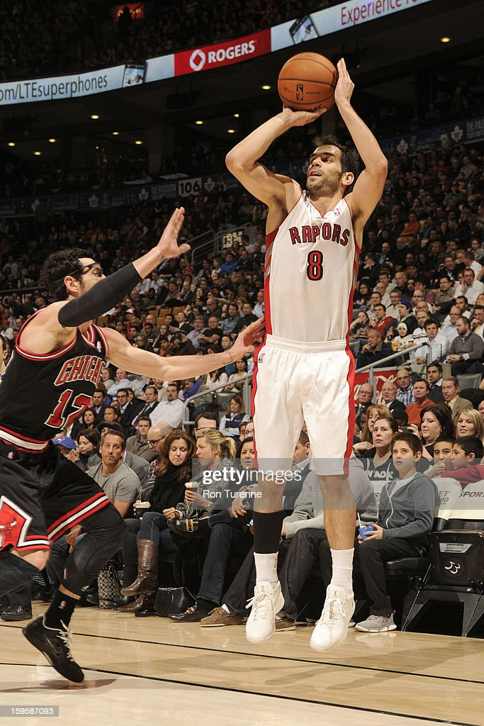 Jose Calderon #8 of the Toronto Raptors goes for a jump shot during the game between the Toronto Raptors and the Chicago Bulls on January 16, 2013 at the Air Canada Centre in Toronto, Ontario, Canada.