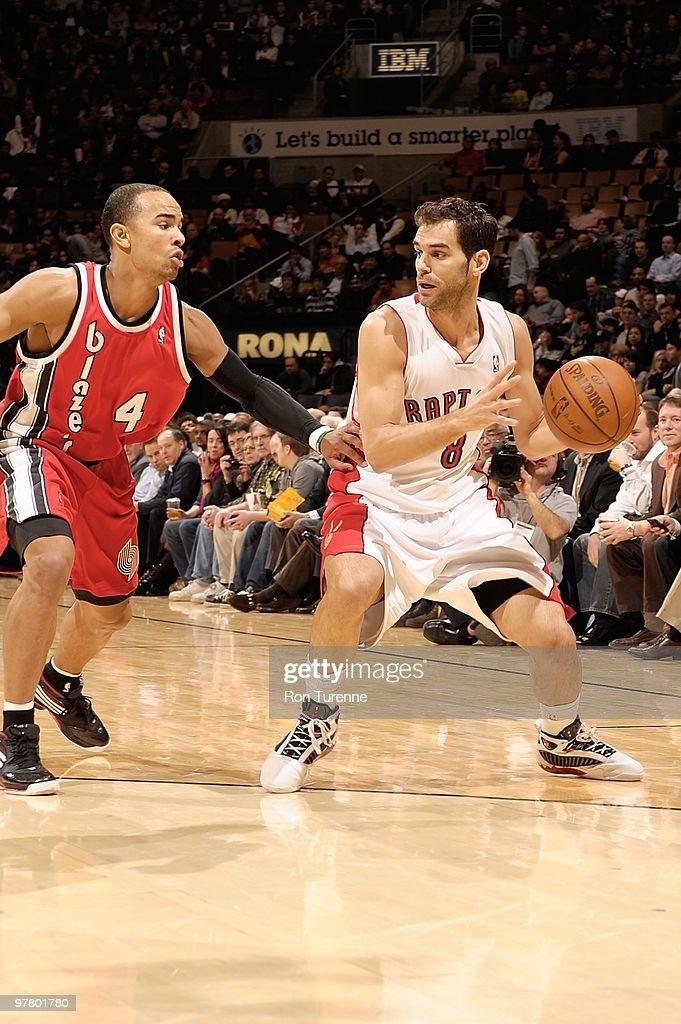 Jose Calderon #8 of the Toronto Raptors handles the ball against Jerryd Bayless #4 of the Portland Trail Blazers during the game on February 24, 2010 at Air Canada Centre in Toronto, Canada. The Blazers won 101-87.