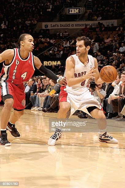 Jose Calderon of the Toronto Raptors handles the ball against Jerryd Bayless of the Portland Trail Blazers during the game on February 24 2010 at Air...