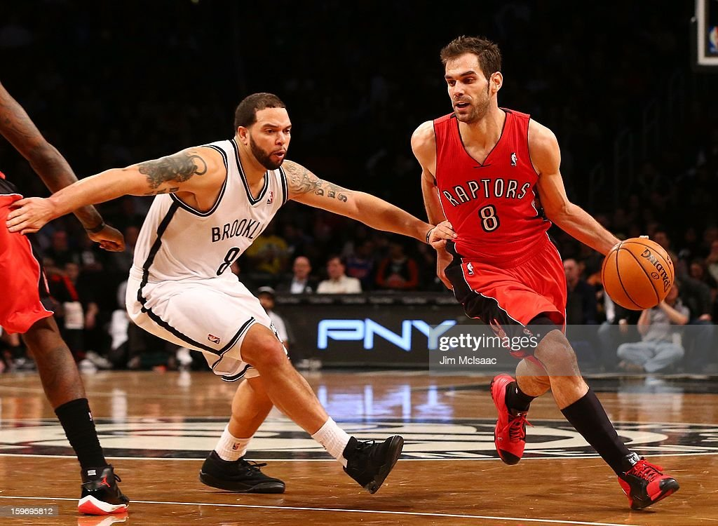 Jose Calderon #8 of the Toronto Raptors in action against Deron Williams #8 of the Brooklyn Nets at Barclays Center on January 15, 2013 in the Brooklyn borough of New York City.The Nets defeated the Raptors 113-106.