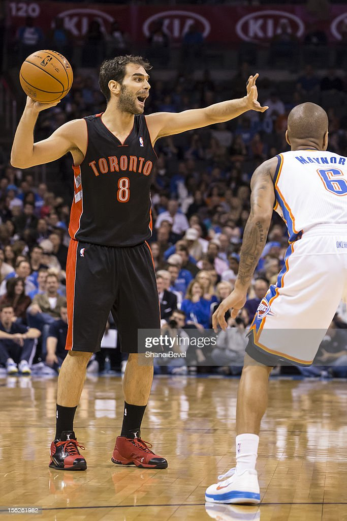 Jose Calderon #8 of the Toronto Raptors in action against Eric Maynor #6 during the NBA basketball game on November 6, 2012 at the Chesapeake Energy Arena in Oklahoma City, Oklahoma.