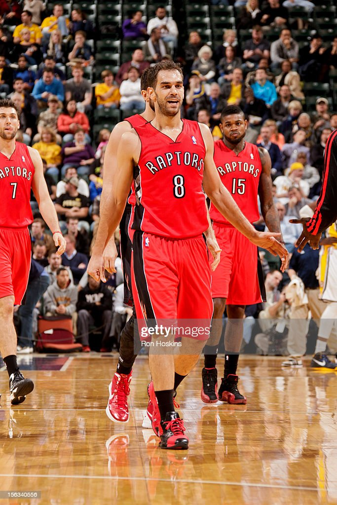 Jose Calderon #8 of the Toronto Raptors is congratulated by teammates during a timeout against the Indiana Pacers on November 13, 2012 at Bankers Life Fieldhouse in Indianapolis, Indiana.