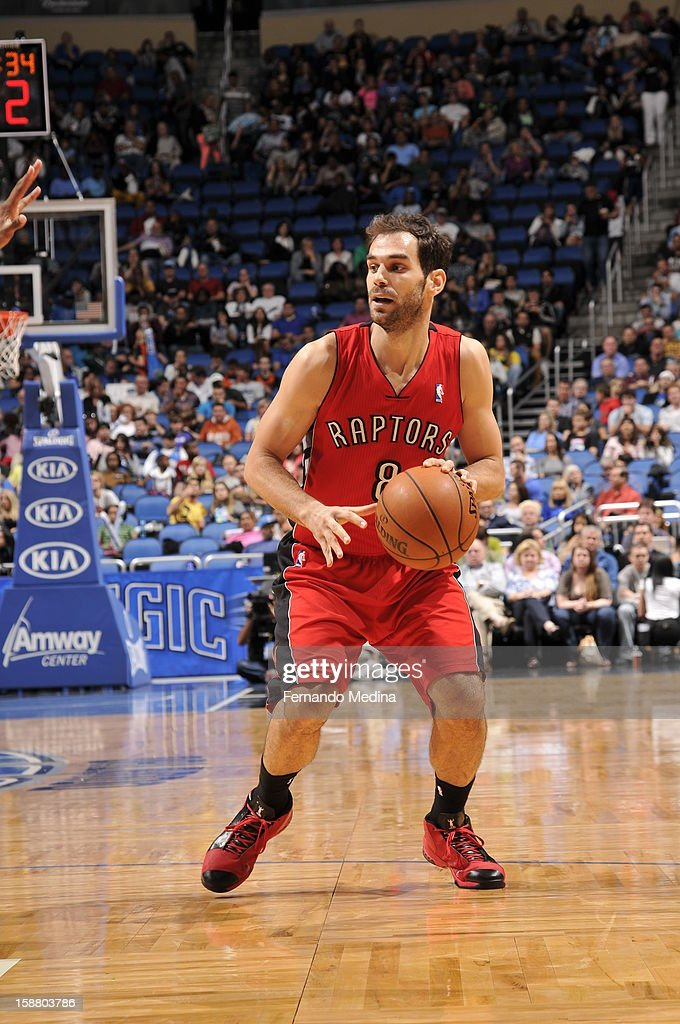 Jose Calderon #8 of the Toronto Raptors looks to pass the ball against the Orlando Magic during the game on December 29, 2012 at Amway Center in Orlando, Florida.