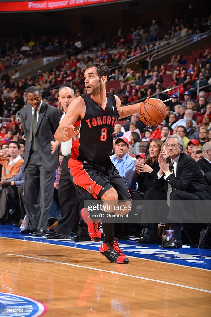 <a gi-track='captionPersonalityLinkClicked' href=/galleries/search?phrase=Jose+Calderon&family=editorial&specificpeople=548297 ng-click='$event.stopPropagation()'>Jose Calderon</a> #8 of the Toronto Raptors looks to pass the ball against the Philadelphia 76ers at the Wells Fargo Center on January 18, 2013 in Philadelphia, Pennsylvania.