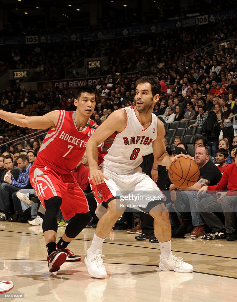 Jose Calderon #8 of the Toronto Raptors protects the ball from Jeremy Lin #7 of the Houston Rocketsc during the game between the Toronto Raptors and the Houston Rockets December 16, 2012 at the Air Canada Centre in Toronto, Ontario, Canada.
