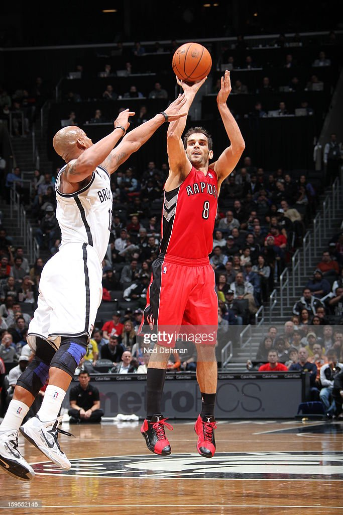 Jose Calderon #8 of the Toronto Raptors shoots against Keith Bogans #10 of the Brooklyn Nets at the Barclays Center on January 15, 2013 in the Brooklyn borough of New York City in New York City.