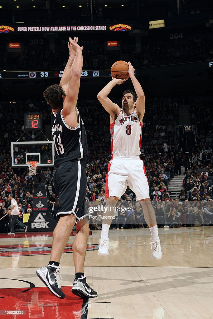 Jose Calderon #8 of the Toronto Raptors shoots against <a gi-track='captionPersonalityLinkClicked' href=/galleries/search?phrase=Kris+Humphries&family=editorial&specificpeople=209199 ng-click='$event.stopPropagation()'>Kris Humphries</a> #43 of the Brooklyn Nets on December 12, 2012 at the Air Canada Centre in Toronto, Ontario, Canada.