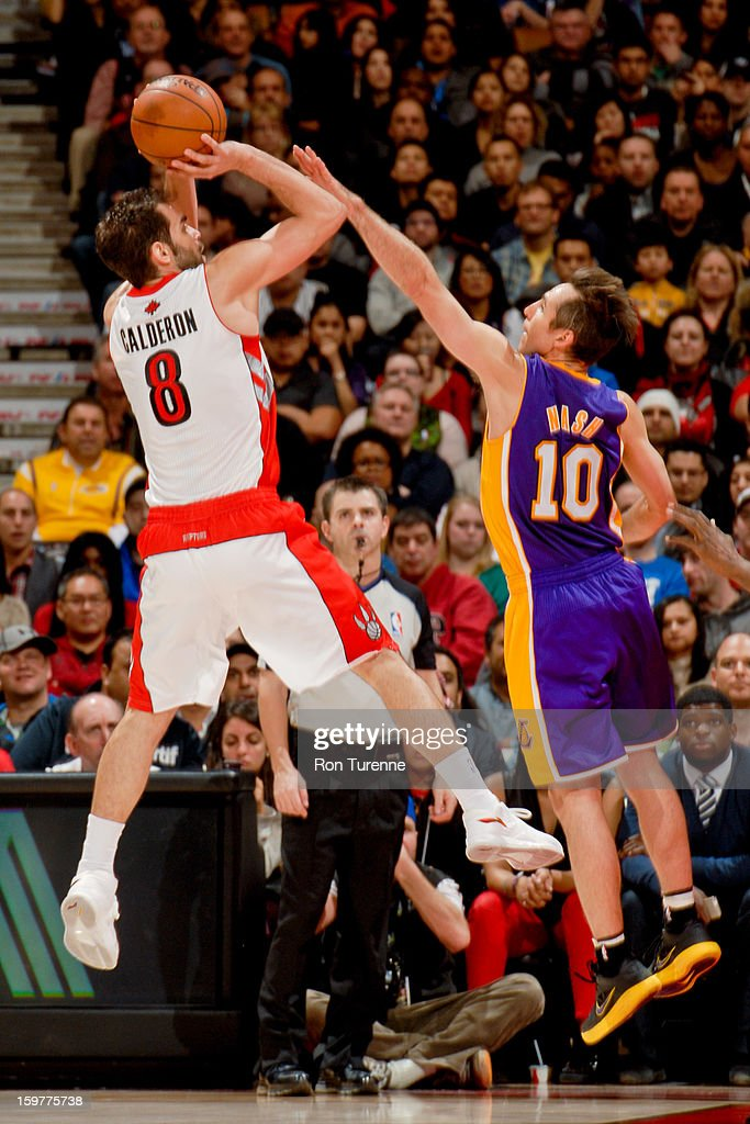 Jose Calderon #8 of the Toronto Raptors shoots against <a gi-track='captionPersonalityLinkClicked' href=/galleries/search?phrase=Steve+Nash+-+Basketball+Player&family=editorial&specificpeople=201513 ng-click='$event.stopPropagation()'>Steve Nash</a> #10 of the Los Angeles Lakers on January 20, 2013 at the Air Canada Centre in Toronto, Ontario, Canada.