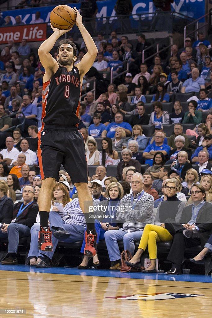 Jose Calderon #8 of the Toronto Raptors shoots against the Oklahoma City Thunder during the NBA basketball game on November 6, 2012 at the Chesapeake Energy Arena in Oklahoma City, Oklahoma.