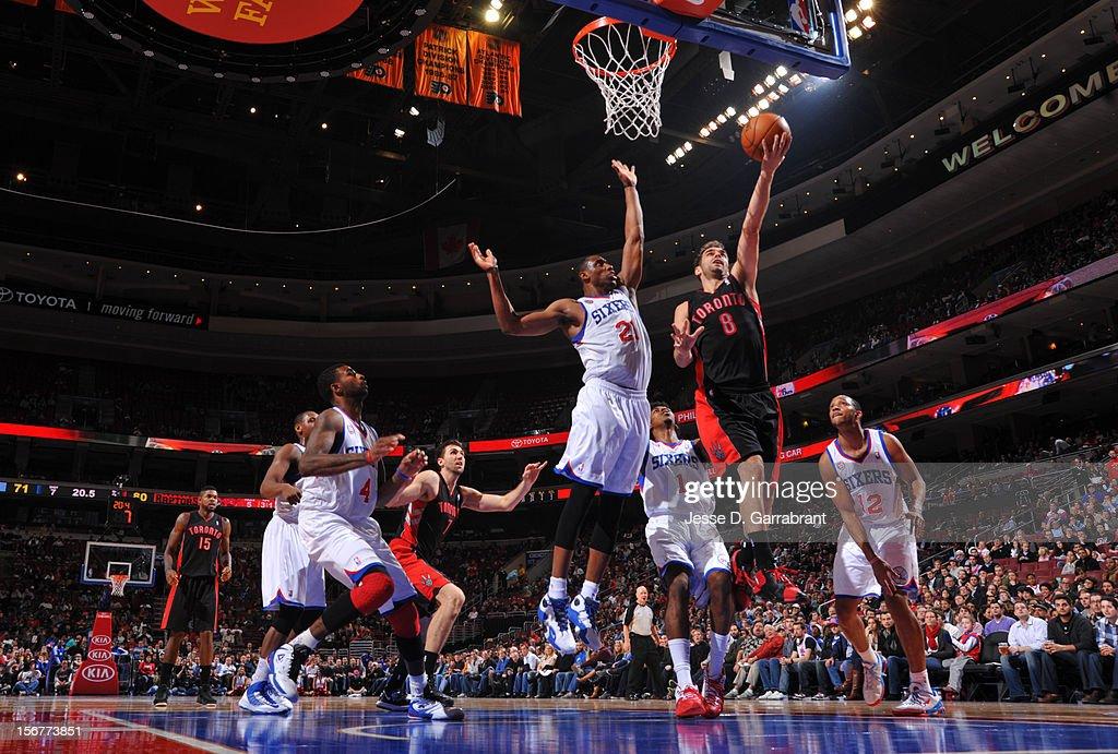 Jose Calderon #8 of the Toronto Raptors shoots the ball against Thaddeus Young #21 of the Philadelphia 76ers during the game at the Wells Fargo Center on November 20, 2012 in Philadelphia, Pennsylvania.