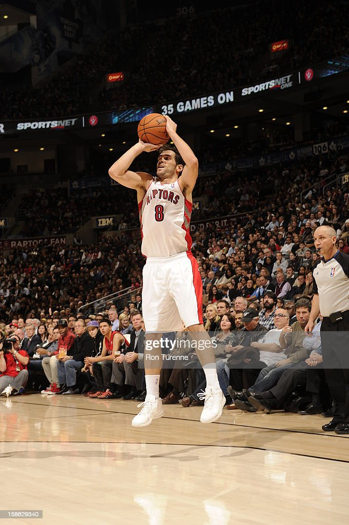 Jose Calderon #8 of the Toronto Raptors shoots the ball against the Brooklyn Nets during the game on December 12, 2012 at the Air Canada Centre in Toronto, Ontario, Canada.