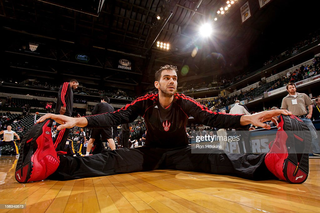 Jose Calderon #8 of the Toronto Raptors stretches before playing against the Indiana Pacers on November 13, 2012 at Bankers Life Fieldhouse in Indianapolis, Indiana.
