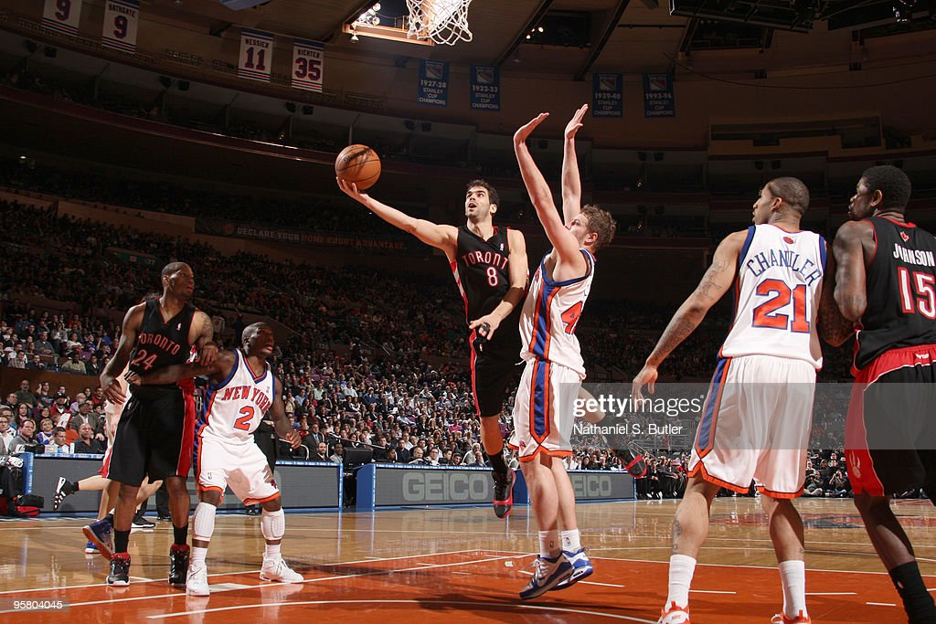 Jose Calderone #8 of the Toronto Raptors shoots against David Lee #42 of the New York Knicks on January 15, 2010 at Madison Square Garden in New York City.