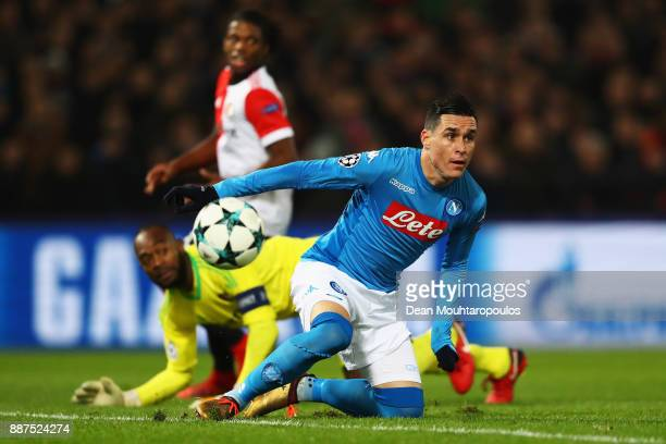Jose Callejon of Napoli battles for the ball with Goalkeeper Kenneth Vermeer of Feyenoord during the UEFA Champions League group F match between...