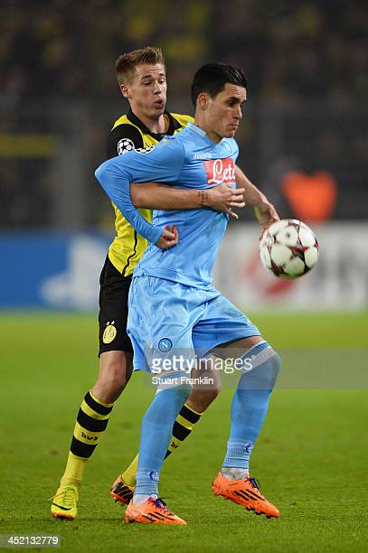 Jose Callejon of Napoli is challenged by Eric Durm of Dortmund during the UEFA Champions League Group F match between Borussia Dortmund and SSC...