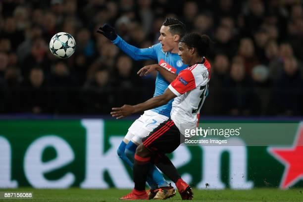 Jose Callejon of Napoli Tyrell Malacia of Feyenoord during the UEFA Champions League match between Feyenoord v Napoli at the Feyenoord Stadium on...