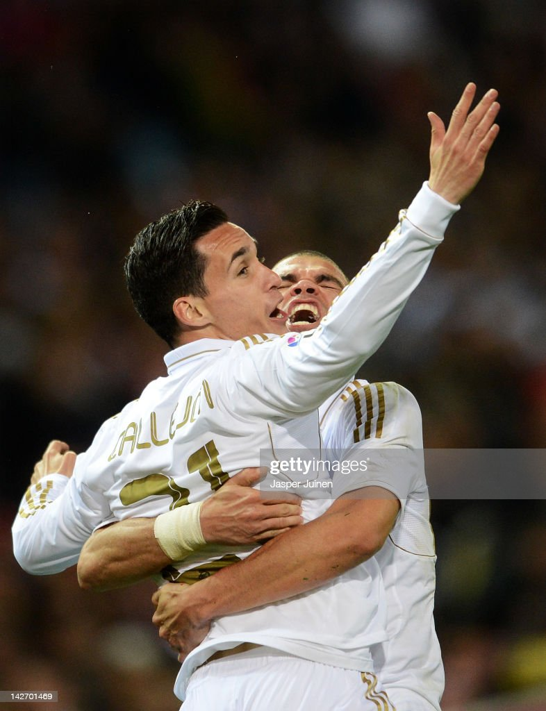 Jose Callejon (L) of Real Madrid celebrates scoring with his teammates Pepe during the La Liga match between Club Atletico de Madrid and Real Madrid CF at the Vicente Calderon Stadium on April 11, 2012 in Madrid, Spain.