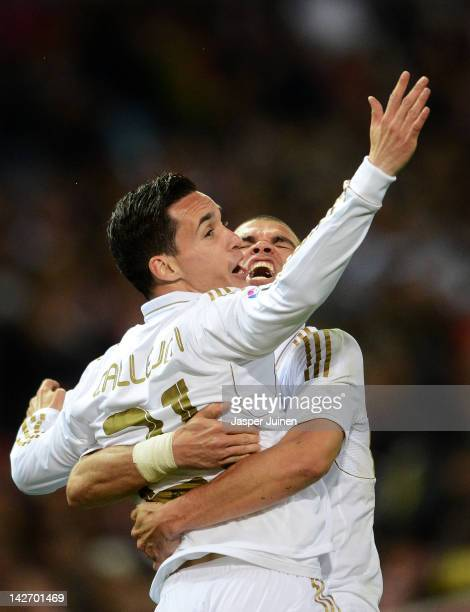 Jose Callejon of Real Madrid celebrates scoring with his teammates Pepe during the La Liga match between Club Atletico de Madrid and Real Madrid CF...