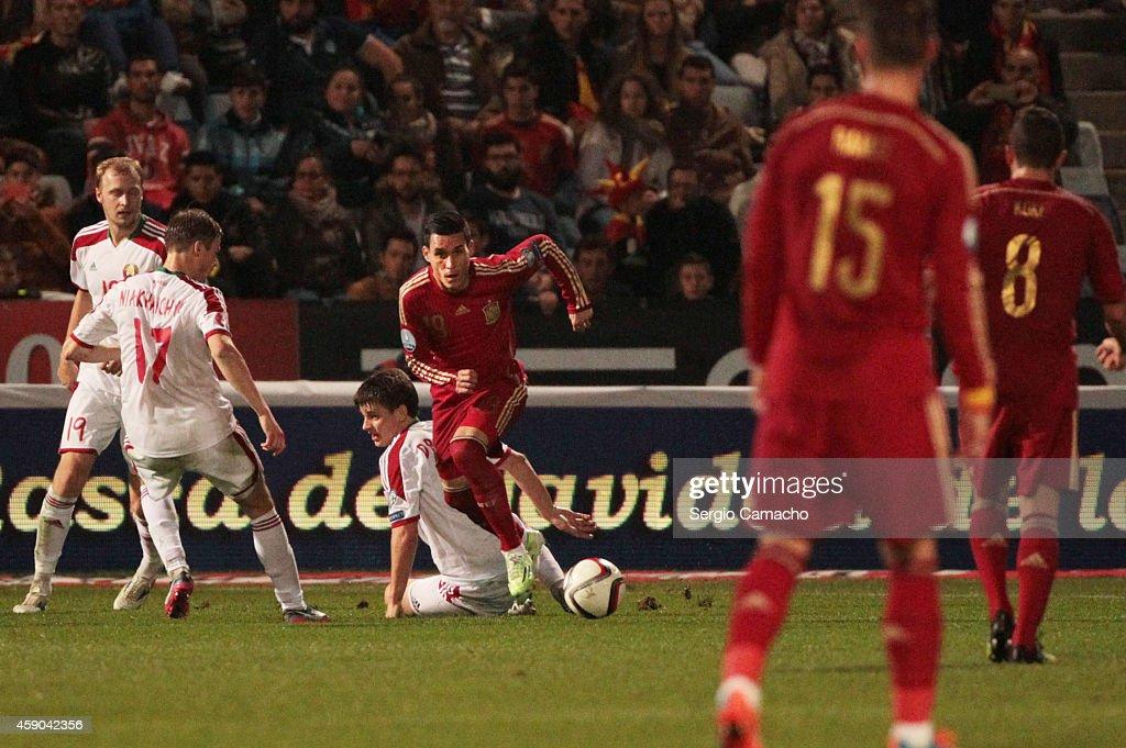 Jose Callejon of Spain beats Stanislav Dragun of Belarus during the UEFA EURO 2016 Group C Qualifier football match between Spain and Belarus at...