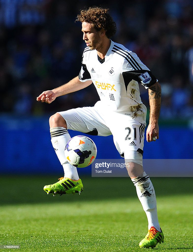 Jose Canas of Swansea City in action during the Barclays Premier League match between Swansea City and West Bromwich Albion at Liberty Stadium on March 15, 2014 in Swansea, Wales.