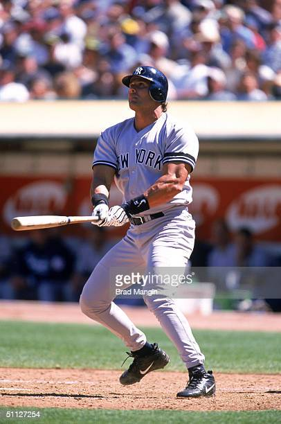 Jose Canseco of the New York Yankees watches the flight of the ball as he stands at the plate during a game of the 2000 MLB season