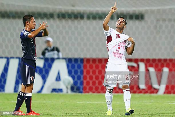 Jose Caraballo of Venezuela celebrates his team's first goal as Ryoma Ishida of Japan reacts during the FIFA U17 World Cup UAE 2013 Group D match...