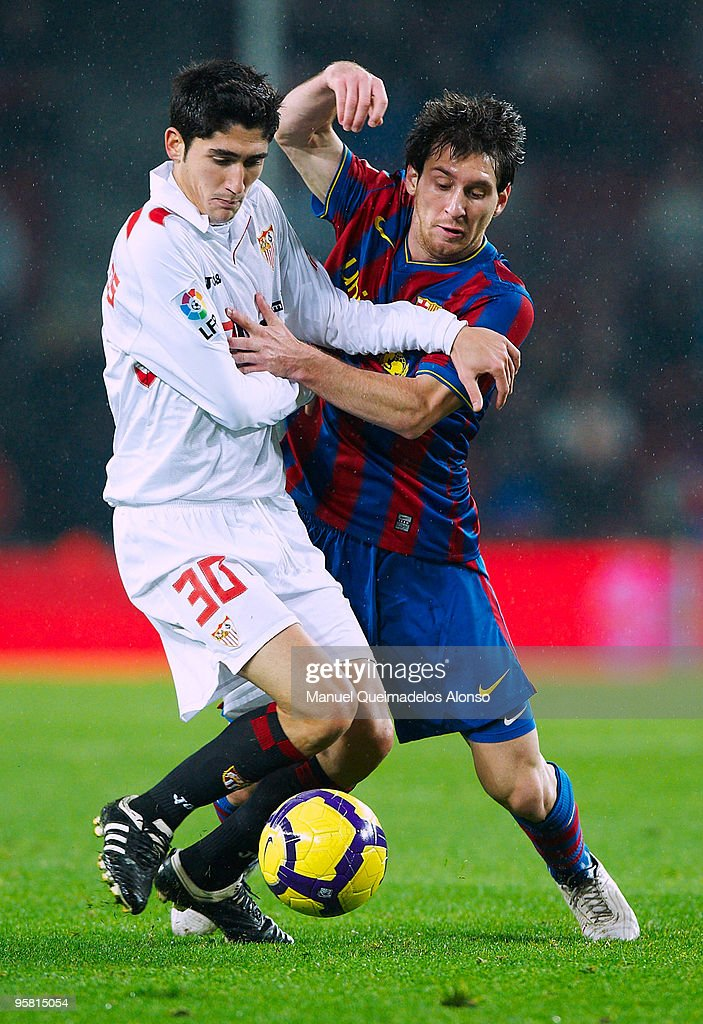 Jose Carlos Fernandez (L) of Sevilla competes for the ball with Lionel Messi of FC Barcelona during the La Liga match between Barcelona and Sevilla at the Camp Nou stadium on January 16, 2010 in Barcelona, Spain.