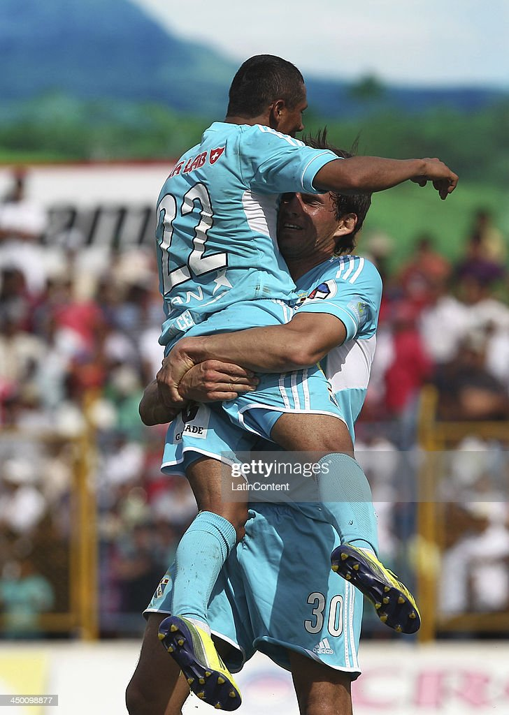 Jose Carlos Fernandez of Sporting Cristal celebrates with William Chiroque a scored goal against Union Comercio during a match between Union Comercio and Sporting Cristal as part of the Torneo Descentralizado at IDP of Moyabamba stadium on November 16, 2013 in Moyabamba, Peru.