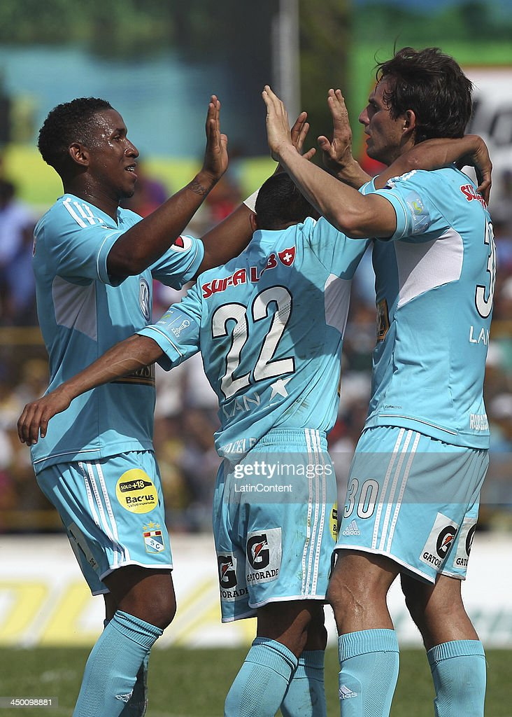 Jose Carlos Fernandez of Sporting Cristal celebrates with William Chiroque and Marcos Ortiz a scored goal against Union Comercio during a match between Union Comercio and Sporting Cristal as part of the Torneo Descentralizado at IDP of Moyabamba stadium on November 16, 2013 in Moyabamba, Peru.