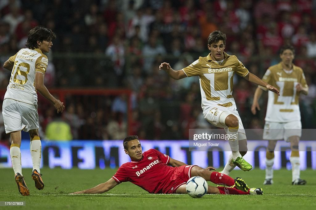 Jose Carlos Van Rankin of Pumas fights for the ball with Carlos Rodriguez of Toluca during a match between Toluca and Pumas as part of the Torneo Apertura 2013 Liga MX at Nemesio Siez stadium, on July 31, 2013 in Toluca, Mexico.