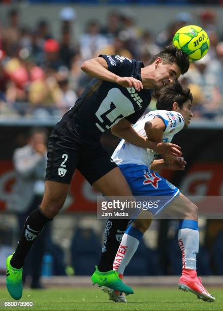 Jose Carlos Van Rankin of Pumas fights for the ball with Carlos Orrantia of Puebla during the 17th round match between Pumas UNAM and Puebla as part...