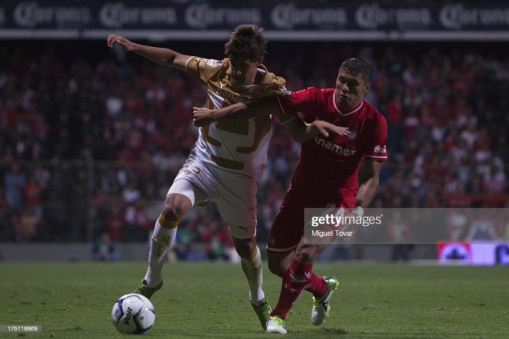 Jose Carlos Van Rankin of Pumas fights for the ball with Richard Ortiz of Toluca during a match between Toluca and Pumas as part of the Torneo Apertura 2013 Liga MX at Nemesio Siez stadium, on July 31, 2013 in Toluca, Mexico.