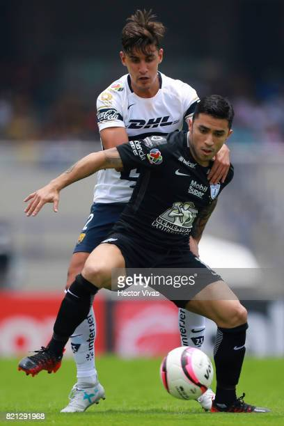 Jose Carlos Van Rankin of Pumas struggles for the ball with Edson Puch of Pachuca during the 1st round match between Pumas UNAM and Pachuca as part...