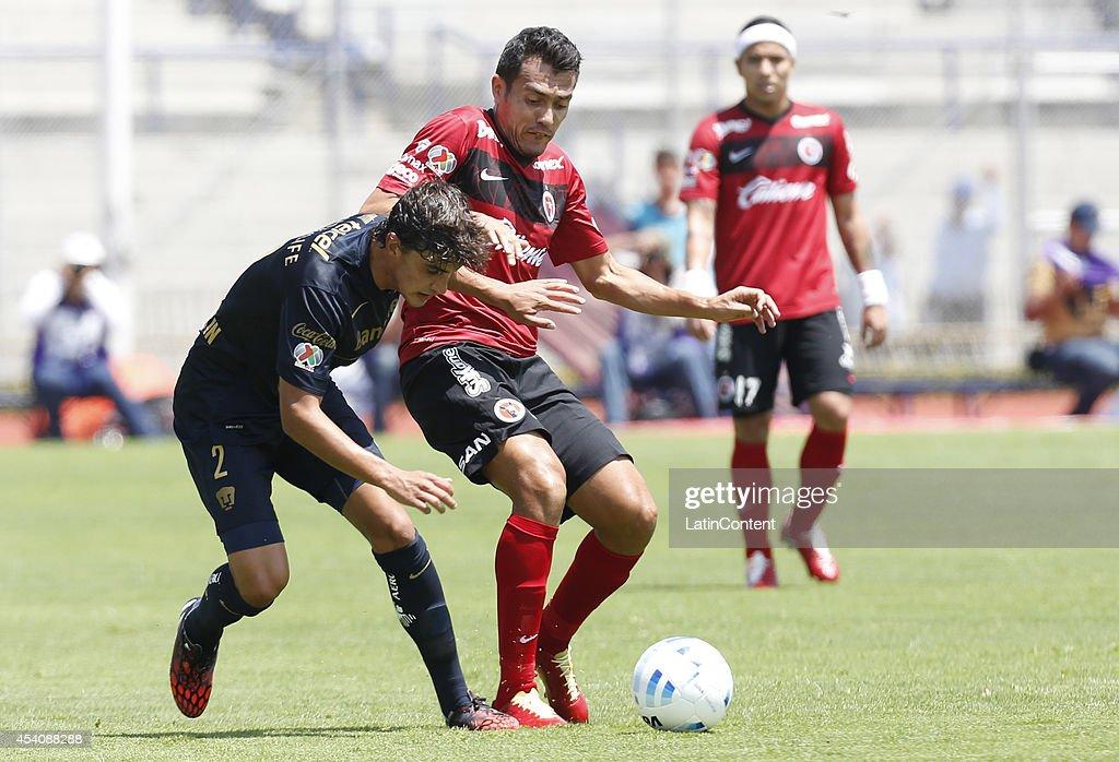 Jose Carlos Van Rankin of Pumas UNAM figths for the ball with Juan Arango of Xolos Tijuana during a match between Pumas UNAM and Xolos Tijuana as part of 6th round Apertura 2014 Liga MX at Olimpic Stadium on August 24, 2014 in Mexico City, Mexico.