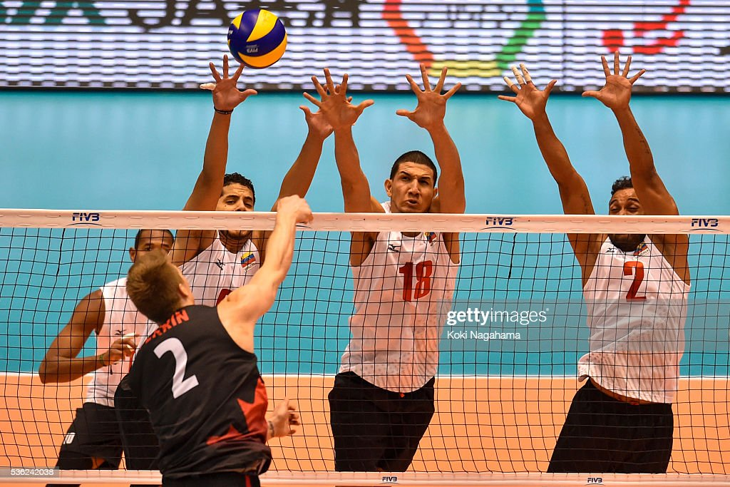 Jose Carrasco #9 and Jonathan Quijada #18 and Jhonlenn Cruz Barreto Pena #2 of Venezuela block the ball during the Men's World Olympic Qualification game between Venezuela and Canada at Tokyo Metropolitan Gymnasium on June 1, 2016 in Tokyo, Japan.