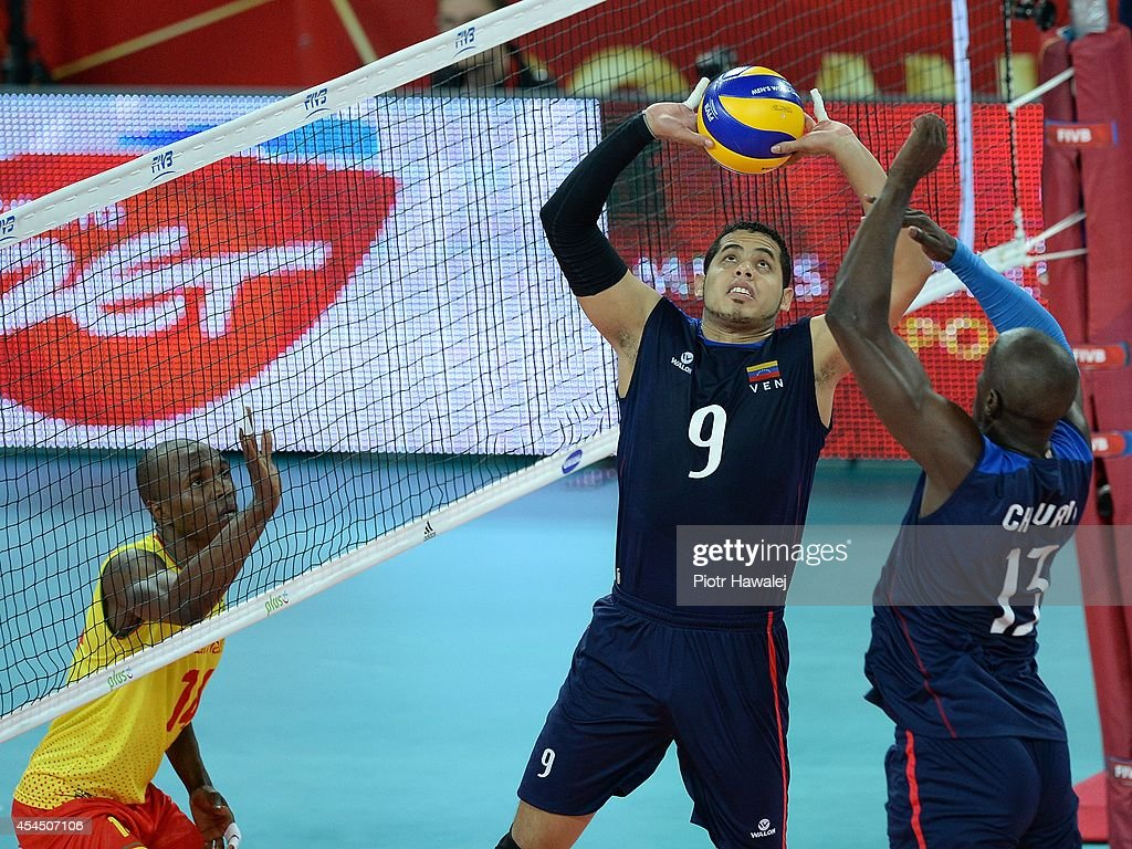 Jose Carrasco of Venezuela setting up during the FIVB World Championships match between Venezuela and Cameroon on September 2, 2014 in Wroclaw, Poland.