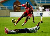 Jose Castillo of America de Cali struggles for the ball with Julio Murillo of Union Magdalena during a match between America de Cali and Union...
