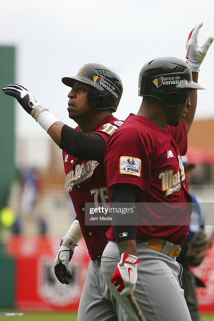 Jose Castillo (L) of Venezuela celebrates during the Caribbean Series 2013 at Sonora Stadium on February 03, 2013 in Hermosillo, Mexico.